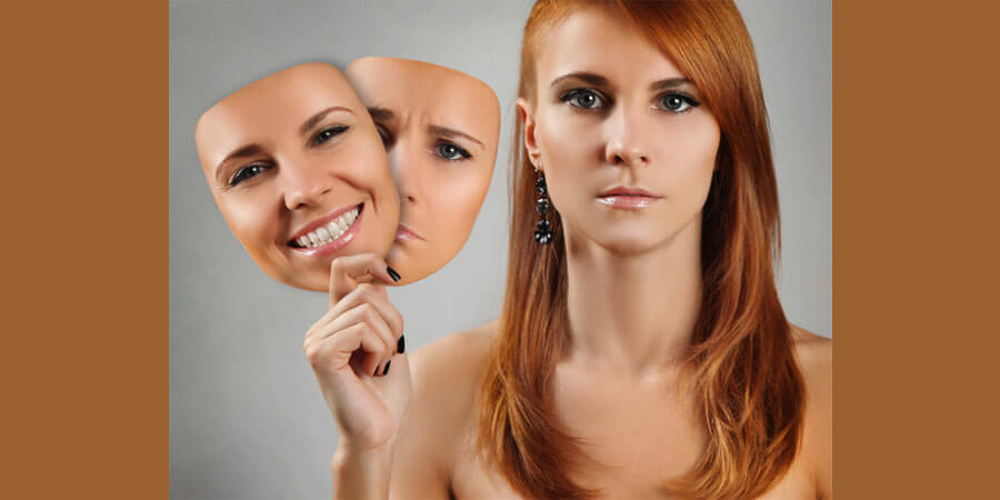 Relationship Faces: White Girls with red hair holding 2 other images of her face with emotions on them.