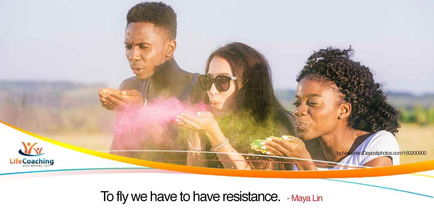 "Image of multiethnic friends blowing paint from hands into air with quote: ""To fly we have to have resistance."" -- Maya Lin"