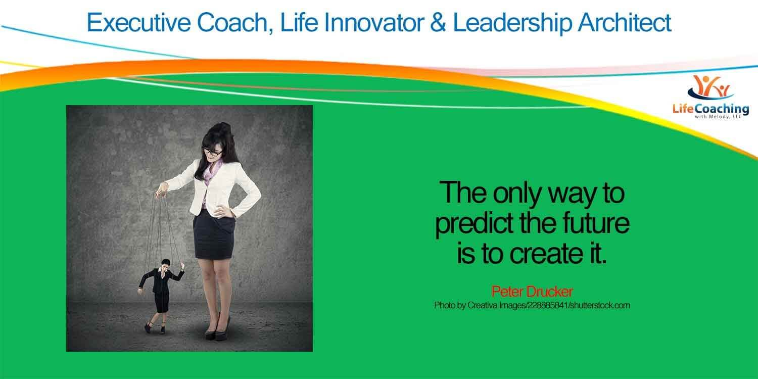 "Image of Female Executive controlling a string puppet of herself. With quote, ""The only way to predict the future is to create it."" - Peter Drucker."