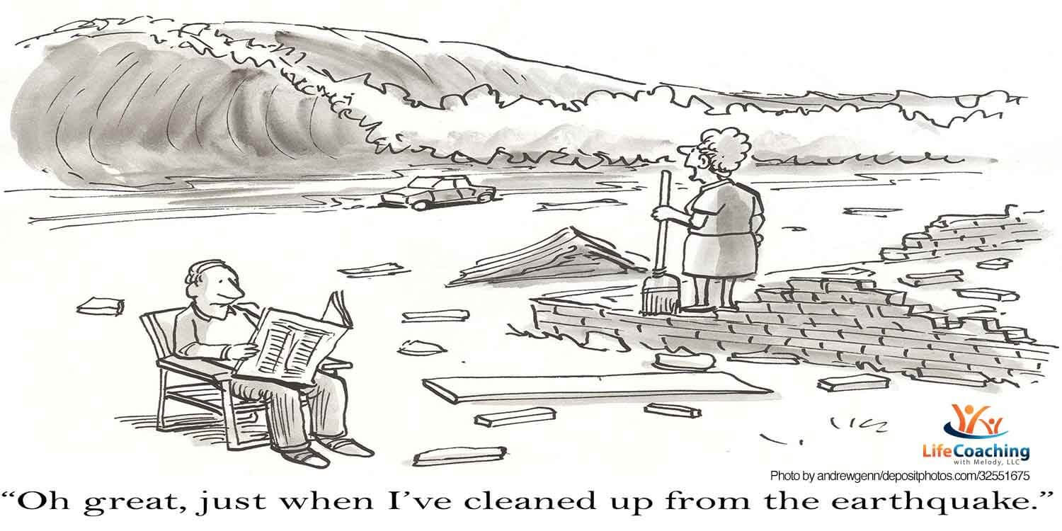 "Cartoon image of man reading newspaper in chair and woman standing on bricks on beach looking at incoming tsunami and words ""Oh great, just when I've cleaned up from the earthquake."" For coaching blog post titled, ""What to do when life is up-in-the-air?"" Crossroads"